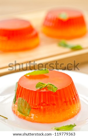 colorful fruit jelly sweets on a white plate - stock photo