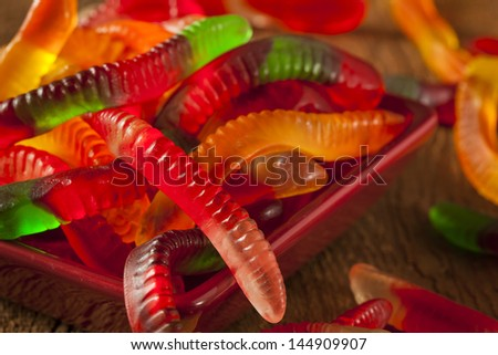 Colorful Fruity Gummy Worm Candy on a background - stock photo