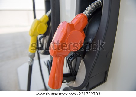 Colorful fuel oil gasoline dispenser at petrol filling station - stock photo