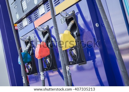 Colorful fuel pumps/Fuel nozzle at gas station in Thailand - stock photo