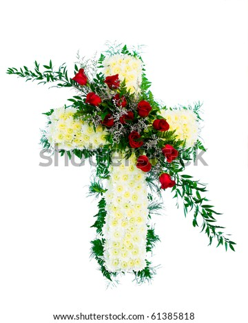 Colorful funeral flower arrangement with Cross design. - stock photo
