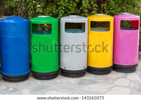 Colorful garbage cans for different kind of garbage, outdoors - stock photo