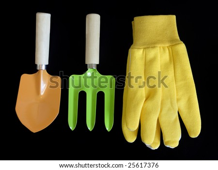 colorful garden tools on black background - stock photo