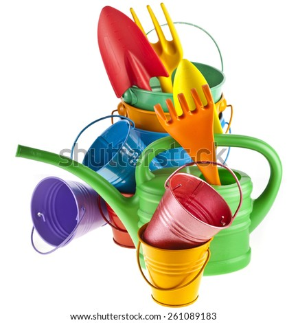 Colorful gardening tools : Watering can, bucket, spade isolated over white background - stock photo