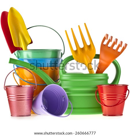 Colorful gardening tools : Watering can, bucket, spade over white background - stock photo