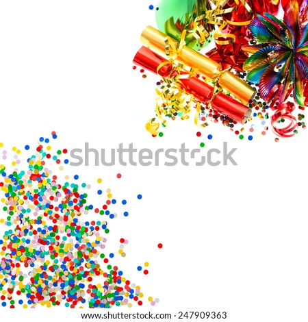 colorful garlands, streamer, cracker, party hats and confetti. holidays decoration background - stock photo