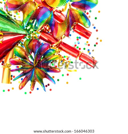 colorful garlands, streamer, party hats and confetti. festive decorations background. carnival items - stock photo