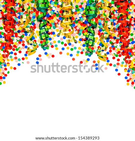colorful garlands, streamer, party hats and confetti on white  background. festive carnival or birthday decoration - stock photo