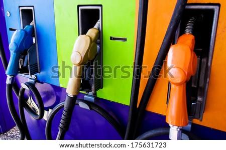 colorful gas pump nozzles - stock photo