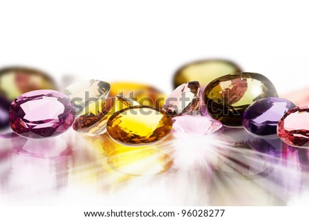 colorful gems on white background - stock photo