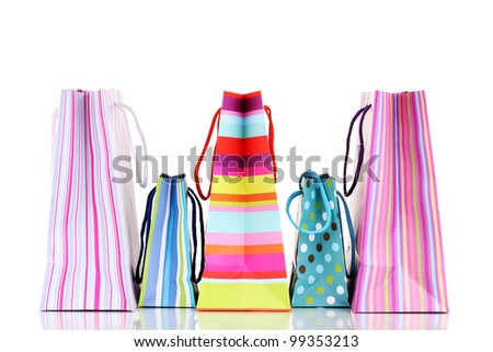Colorful gift bags isolated on white - stock photo