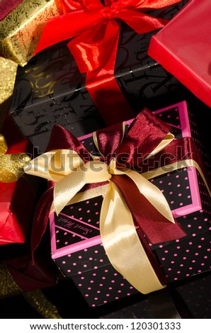 Colorful gift boxes isolated on black background closeup - stock photo