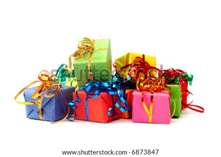 Colorful gifts with shining ribbons on white - stock photo