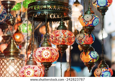 Colorful glass mosaic lamps at a lampshop in Istanbul bazaar, Turkey - stock photo