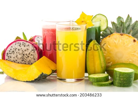 Colorful glass of healthy drink from fresh fruit and vegetable - stock photo