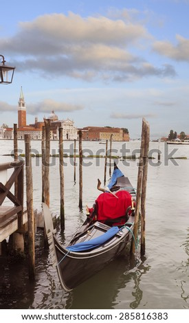 Colorful Gondola at Sunset in Venice, Italy - stock photo