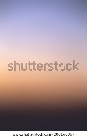 Colorful gradient of the sky at the cloudless sunset - stock photo