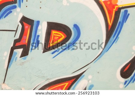 Colorful graffiti wall with spray a paint. Blue and orange background. Urban art.  - stock photo