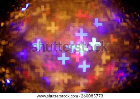 colorful greek cross bokeh background - stock photo
