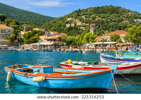 Colorful Greek fishing boats in port of Kioni on Ithaka island, Greece - stock photo