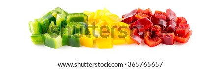 Colorful green, yellow and red capsicum peppers diced against white - stock photo