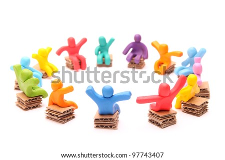 colorful group of plasticine people having a meeting sitting on chairs - isolated on white - stock photo