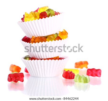 Colorful gummy bear candies over white background - stock photo
