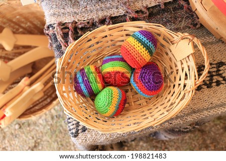 Colorful hacky sacks in a basket. - stock photo