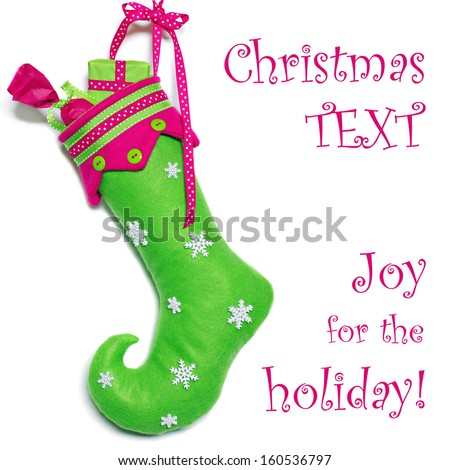 Colorful handcrafted curly toe Christmas stocking on white background with copy space. - stock photo