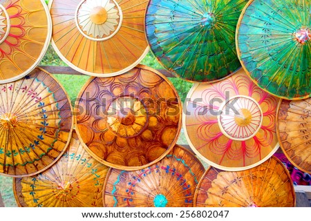 colorful handmade bamboo umbrella's / parasols . handicraft in Asia - stock photo