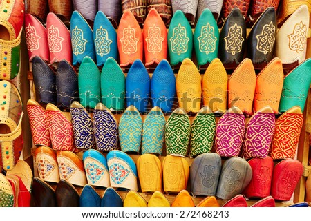 Colorful handmade leather slippers (babouches) on a market in Marrakech, Morocco - stock photo