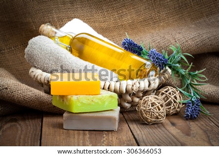 colorful handmade soap bars with oil, on wooden background - stock photo