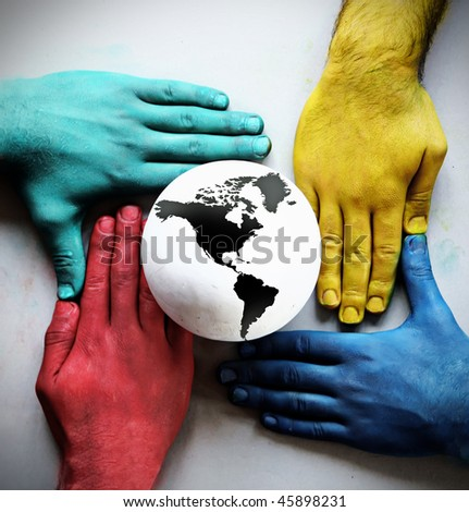 colorful hands holding the earth - stock photo
