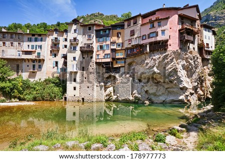 Colorful hanging houses  is  original architecture in  Pont-en-Royans, France. - stock photo