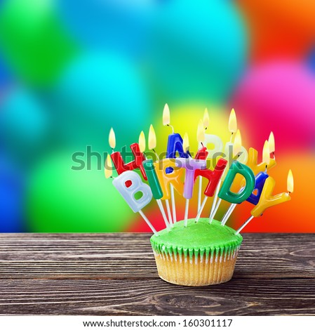 colorful happy birthday cupcakes with candles - stock photo