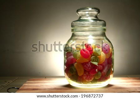 Colorful Hard candies in a jar Photo of colorful hard candies in a jar - stock photo