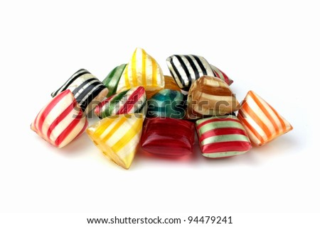 Colorful hard candies on a white background - stock photo
