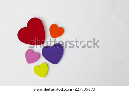 Colorful hearts on bright white background.  Plenty of room for text. - stock photo