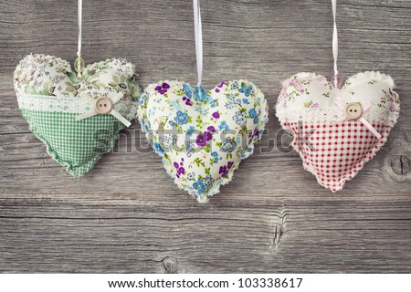Colorful hearts on wooden background - stock photo