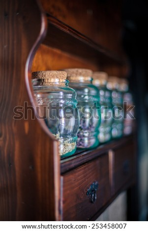 Colorful herbs,spices and aromatic ingredients on wooden shelf. Shallow depth of field. - stock photo