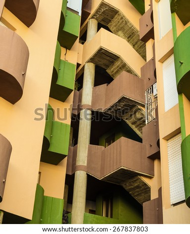 Colorful high rise building facade with curved  lines - stock photo