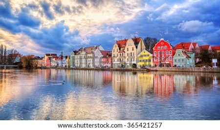 Colorful historical houses on Isar river in an old gothic town Landshut by Munich, Germany - stock photo