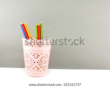 colorful holder full of pen and pencil office equipment for eduation or business still life - stock photo