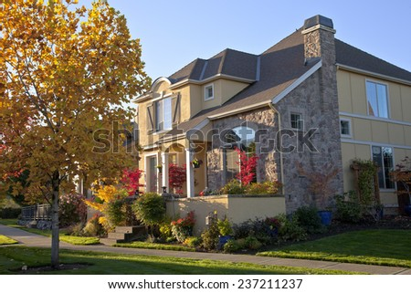 Colorful home with plants and trees Willsonville Oregon. - stock photo