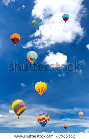 colorful hot air balloon against blue sky - stock photo