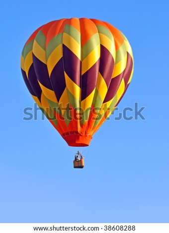 Colorful hot air balloon with diagonal stripes - stock photo