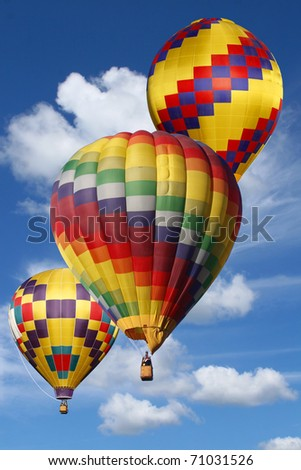 Colorful Hot Air Balloons in a Beautiful Cloudy Sky - stock photo