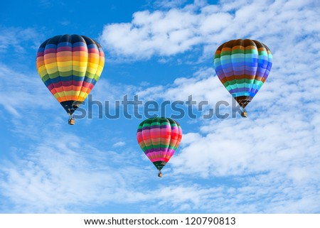 Colorful hot air balloons on the blue sky - stock photo