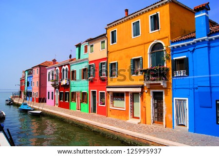 Colorful houses along a canal in Burano near Venice, Italy - stock photo