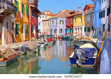 colorful houses by the water canal at the island Burano near venice, Italy - stock photo